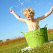 Child Splashing Water and Bubbles in Wash Tub — Stock Photo