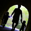 Father and Children Exploring Dark Tunnel — Stock Photo