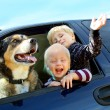 Happy Children and Dog in Minivan — Stock Photo #32084555