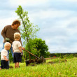 Family Planting Tree — Stock Photo
