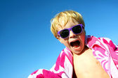 Hip Excited Child in Beach Towel and Sunglasses — Stock Photo