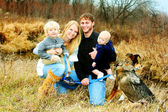 Happy Family by River in Late Autum — Stock Photo