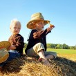 Children Playing Outside on Hay Bale — Stock Photo