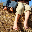 Feet of Little Boys Sitting on Top of Hay Bale — Stock Photo