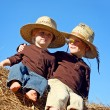 Happy Little Boys Sitting on Hay Bale — Stock Photo