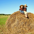 Happy Little Kids Sitting on Hay Bale at Farm — Stock Photo