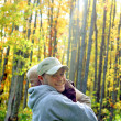 Stock Photo: Father and Son Hugging in Autumn Forest