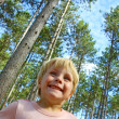 Stock Photo: Happy Boy Standing Outside Under Pine Tree Forest