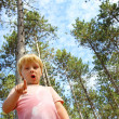 Stock Photo: Young Child in Forest Pointing at Camera