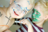 Children Coloring Their Faces with Markers — Stock Photo