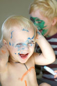 Laughing Young Children Coloring Each Other with Markers — Stock Photo