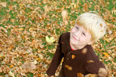 Happy Child in Falling Leaves — Stock Photo