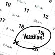 Word Vacation is Written and Circled on Calendar — Stock Photo #34385521