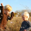 Young Children Playing Outside in Autumn — Stock Photo #34386035