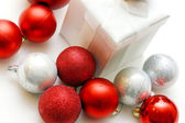 Christmas Present Surrounded By Ornaments — Stockfoto