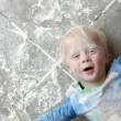 Messy Baby Covered in Baking Flour — Stock Photo #35936137