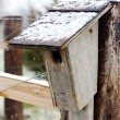 Old Homemade Birdhouse on Farm Fence in Snow — Stock Photo