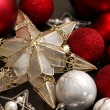 Gold Christmas Tree Star and Red Bulbs — Stock Photo