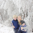 Mother and Two Children in Winter Wonderland — Foto Stock