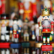 Christmas Nutcracker in front of Collection of Toy Soldiers — Stock Photo