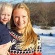 Stock Photo: Happy Mother and Baby Outside in Winter