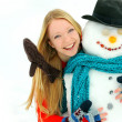 Woman and Snowman Outside in Winter — Stock Photo