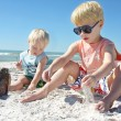 Young Children Playing in the Sand at the Beach — Stock Photo #39948137