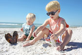 Young Children Playing in the Sand at the Beach — Stock Photo