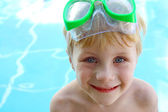 Young Child with Goggles at Swimming Pool — Stock Photo