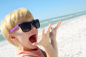 Excited Child on Beach by Ocean — Stock Photo