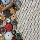 Vintage Sewing Buttons Framing Fabric Square Background — Zdjęcie stockowe
