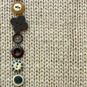 Row of Vintage Buttons Lined up on Soft Square Fabric Background — Stock Photo
