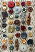 Collection of Vintage Buttons Scattered on Fabric Background — Стоковое фото