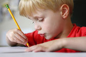 Young Child Drawing with Paper and Pencil — Stock Photo