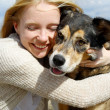 Close up of Woman Hugging German Shepherd Dog — Stockfoto