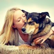 Woman Tenderly Hugging and Kissing Pet Dog — Stock Photo #44516567