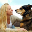 Woman Petting her German Shepherd Dog Outside — Stock Photo
