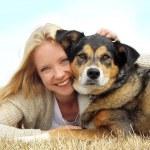 Smiling Woman Hugging German Shepherd Dog — Stock Photo #44516693