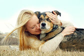 Woman Lovingly Hugging German Shepherd Dog — Stock Photo