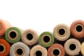 Vintage Yarn Spools Bordering White Background — Stock Photo