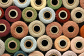Collection of Natural Colored Vintage Yarn Spools Background — Stock Photo