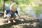 Young Child Playing in Mud by River — Stock Photo