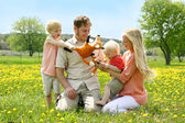 Happy Family of Four People Playing with Toys Outside in Flower  — Stock Photo