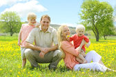 Happy Familly of Four People Relaxing in Flower Meadow — Foto Stock