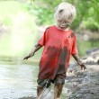 Muddy Little Boy Playing Outside in the River — Stock Photo #47474041