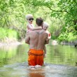 Father and Young Children Walking in River in Forest — Stok fotoğraf