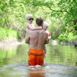 Father and Young Children Walking in River in Forest — 图库照片