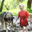 Young Child and Dog Playing in Muddy River — Stock Photo