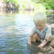 Young Child Sitting in the River During Summer — Stock Photo #47474383