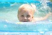 Happy Baby Playing in Swimming Pool — Stock Photo